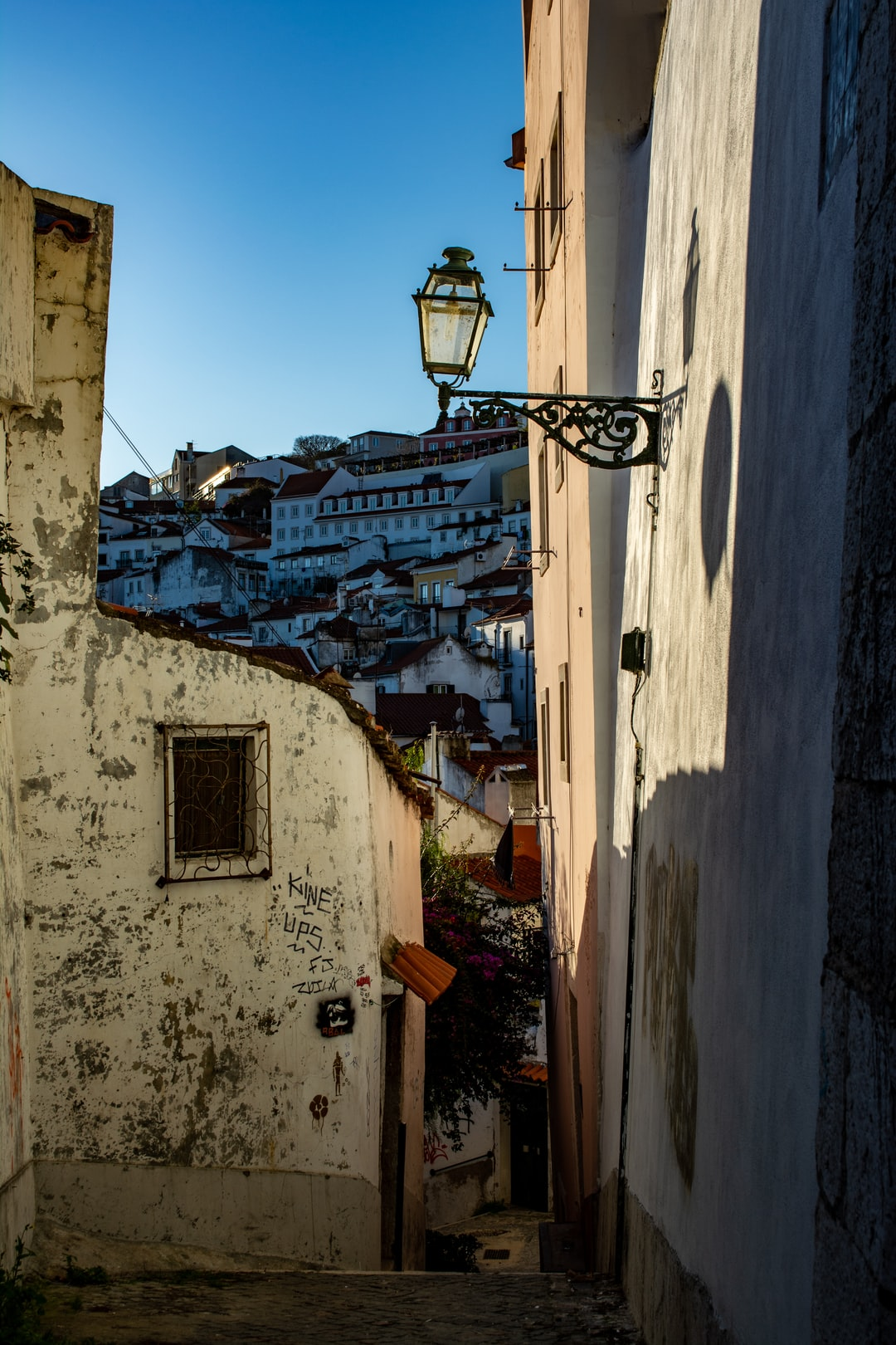 Narrow and steep alley blending the past and the present of Lisbon