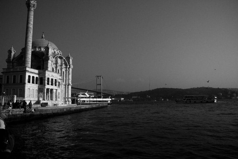 grayscale photography of Ortaköy Mosque in Istanbul, Turkey building near body of water