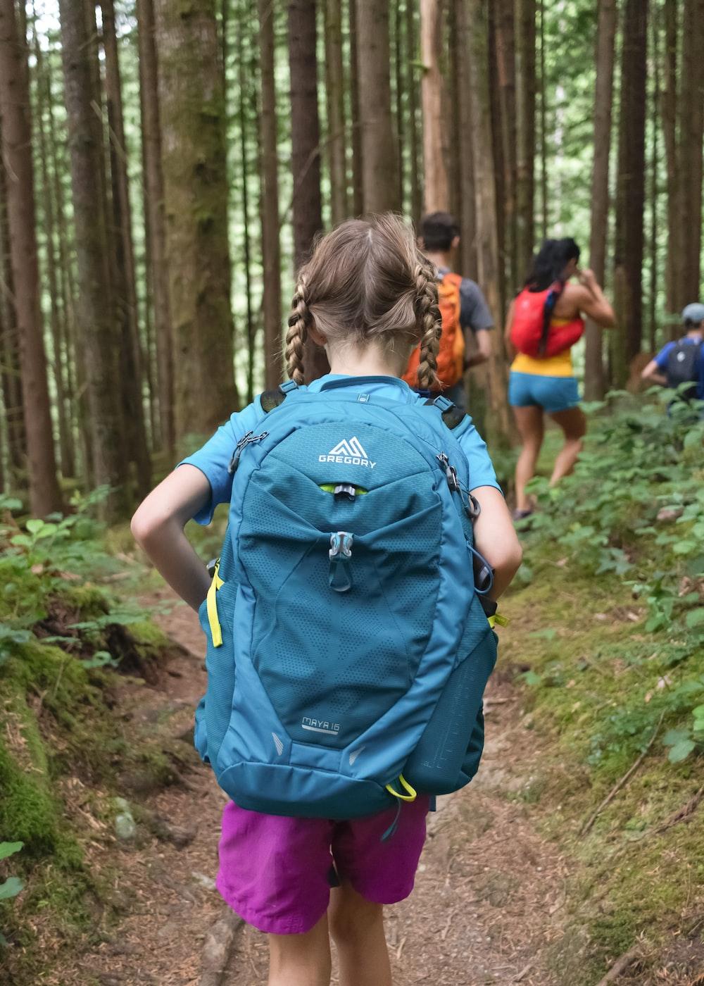 girl wearing blue backpack