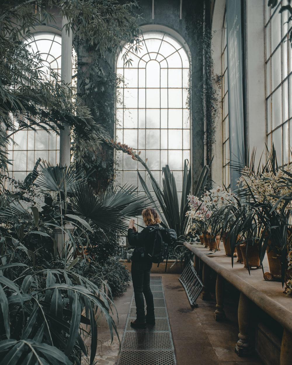 woman inside green house