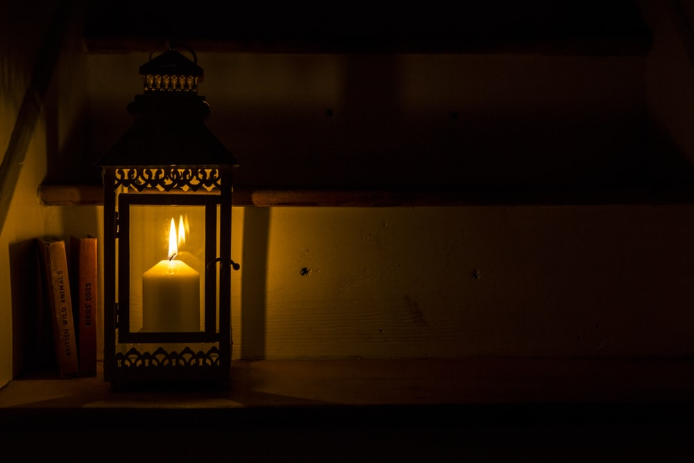 lighted black candle lantern