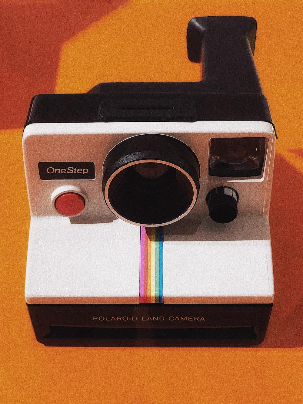 white and black Polaroid OneStep land camera
