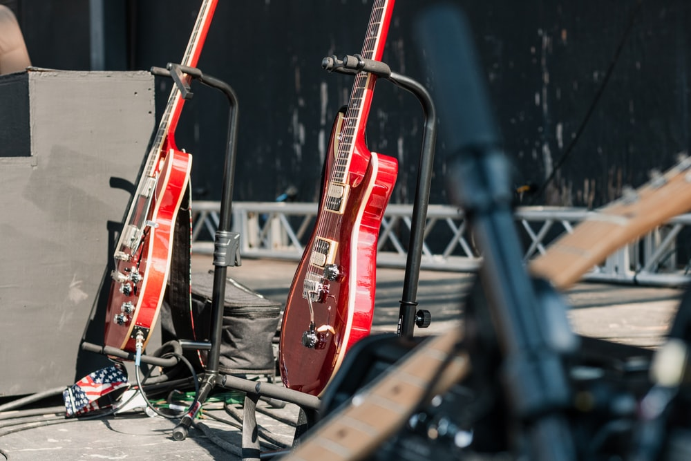 two red electric guitars