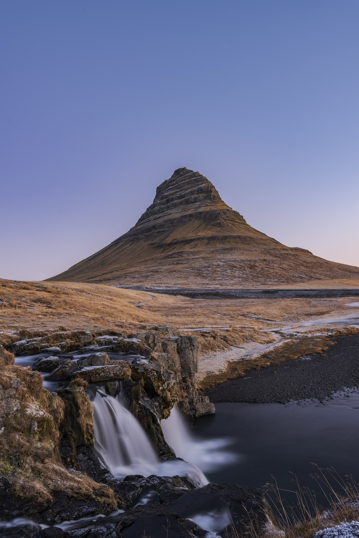 water falls near mountain