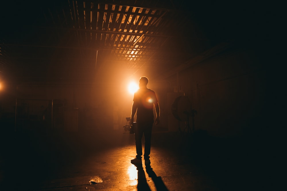 silhouette photography of man inside building
