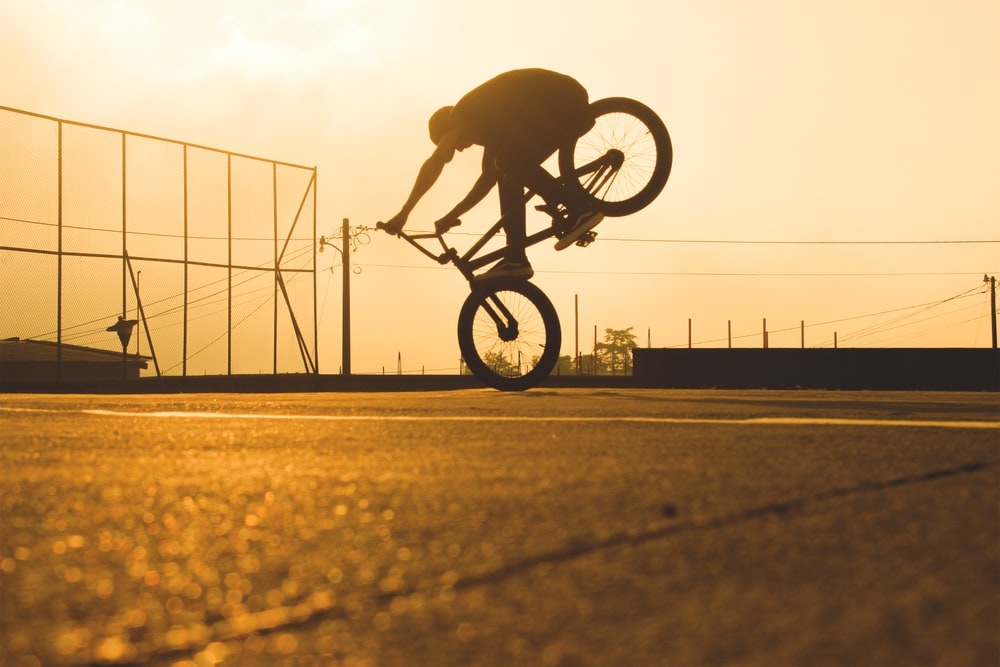 person riding BMX bicycle