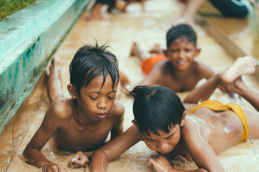 boy's drenched on rain