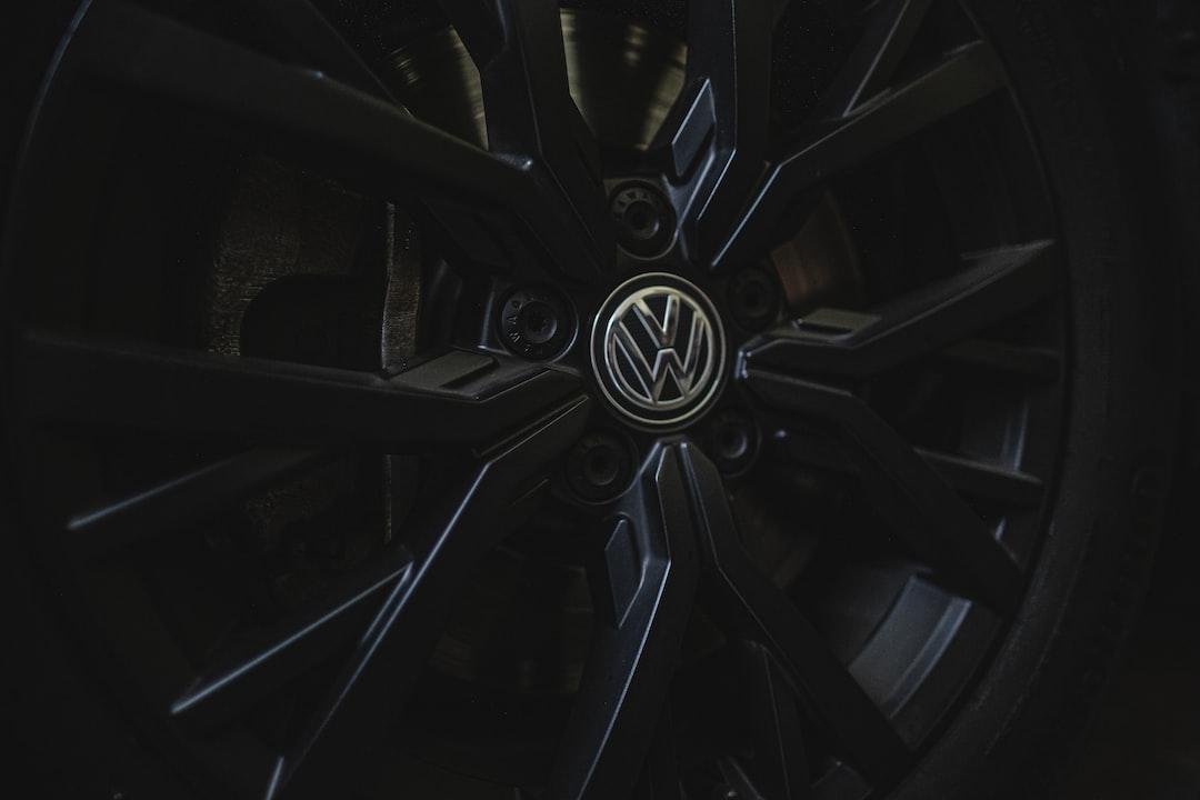 Closeup detail shot of a matte black VW rim.