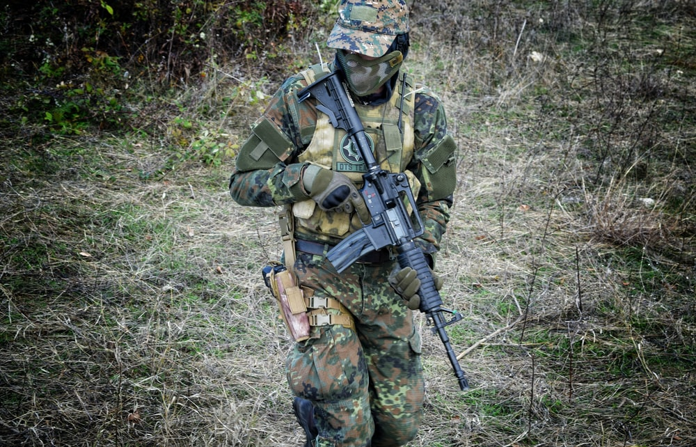 soldier holding rifle
