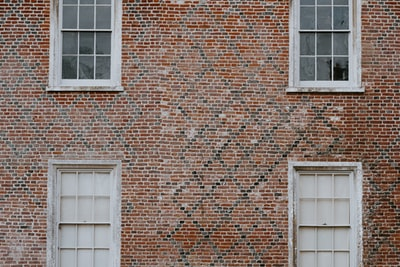 Brick wall with  old fashioned windows