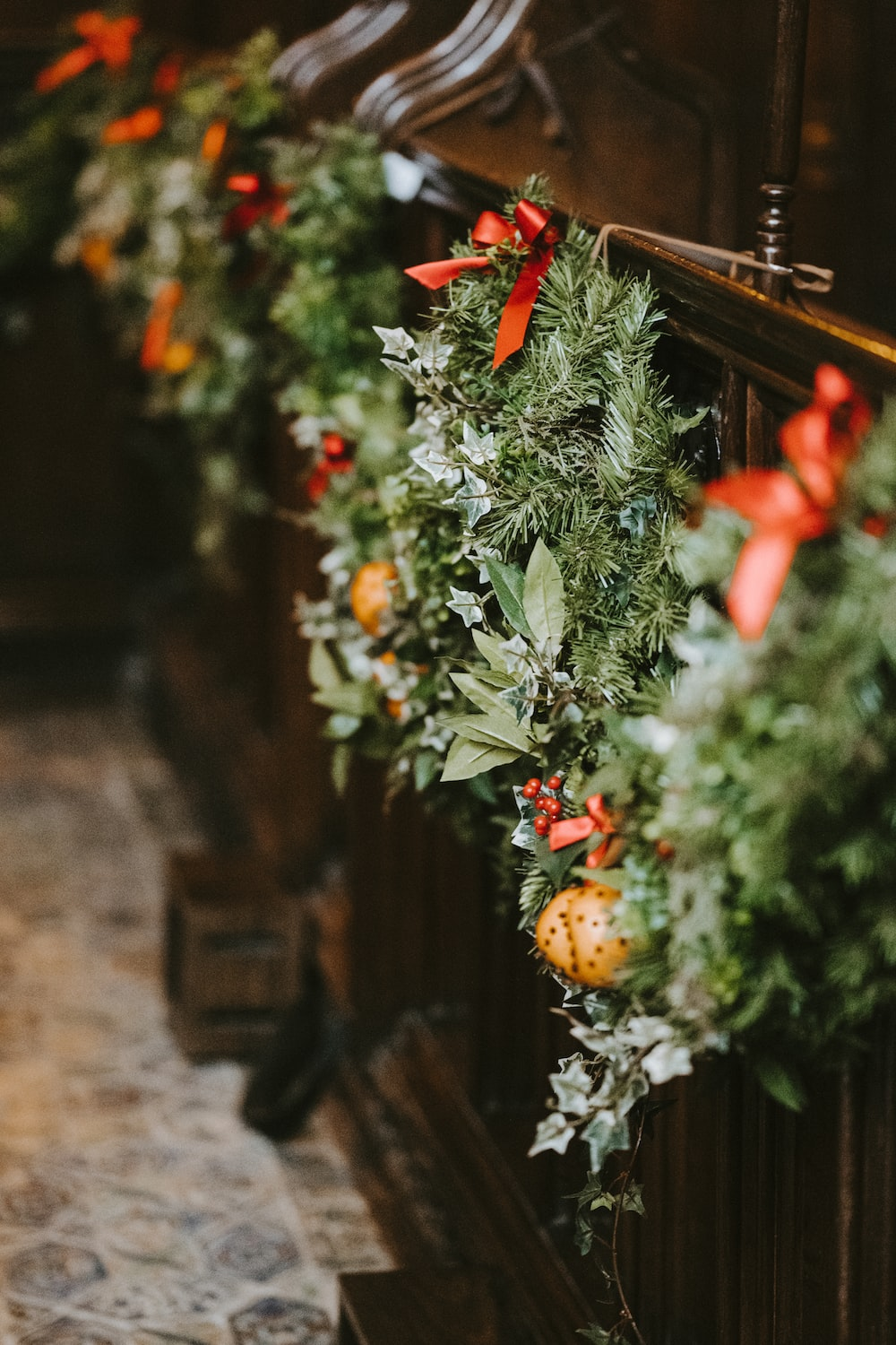 several green Christmas wreaths hanging on wall