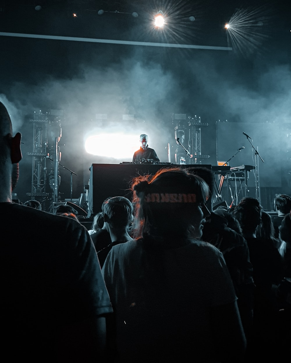 DJ performing on stage in front of people