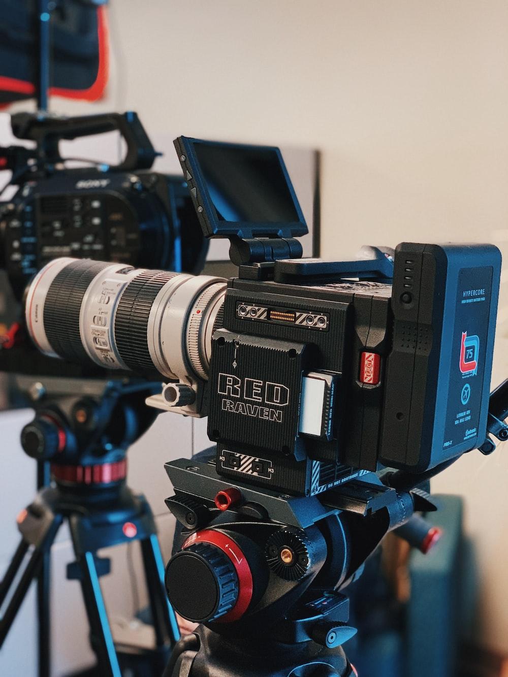 black and red camera tripod