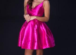 woman in pink satin dress