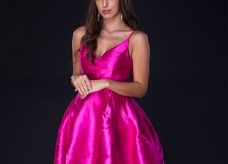 woman in pink satin dress