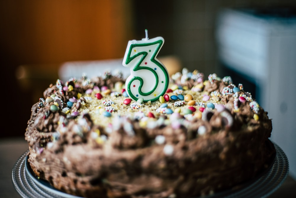 chocolate cake with number 3 candle on top