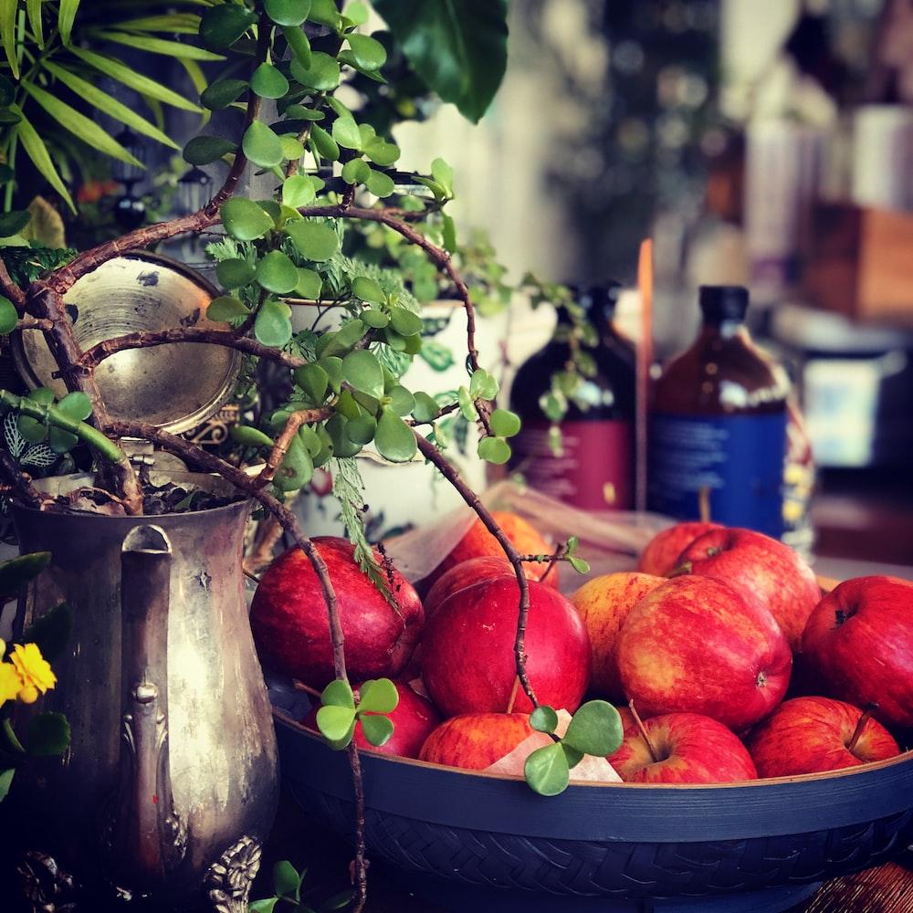 red apples in black basket