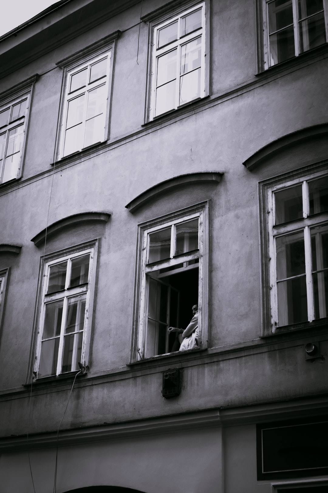 Lonely and isolated man looking from window during quarantine