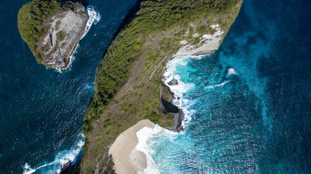 aerial photo of island on sea
