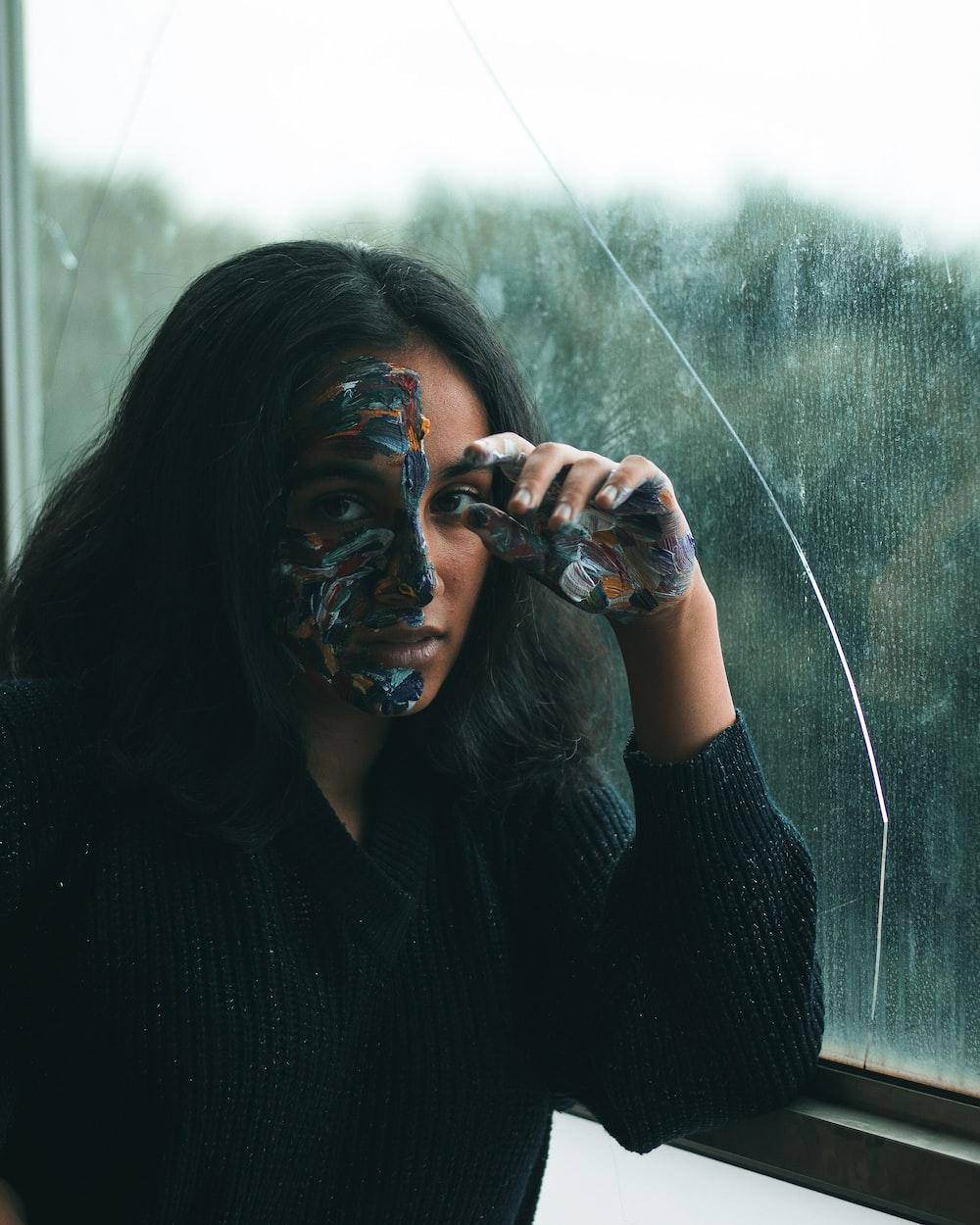 woman leaning beside window