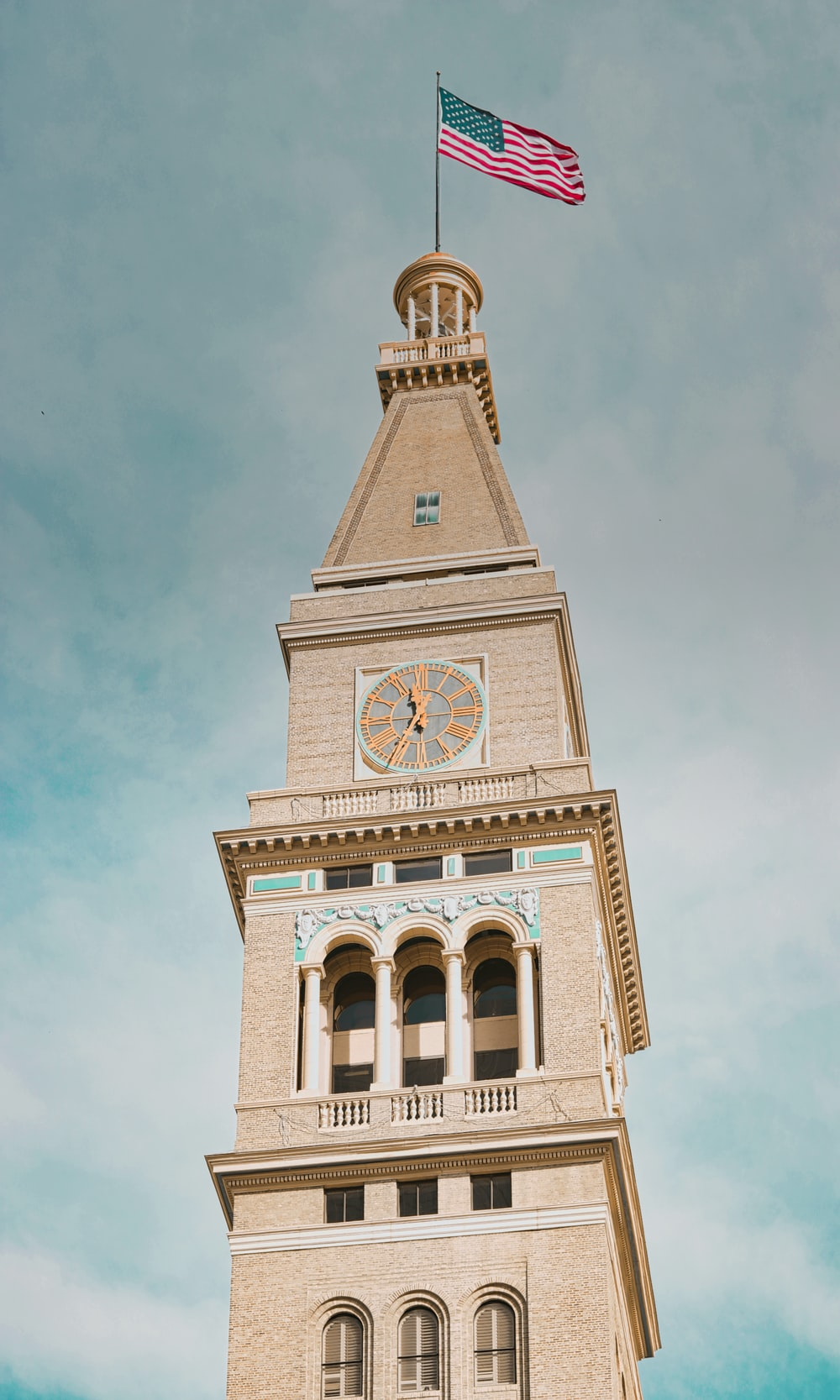 beige and white clock tower