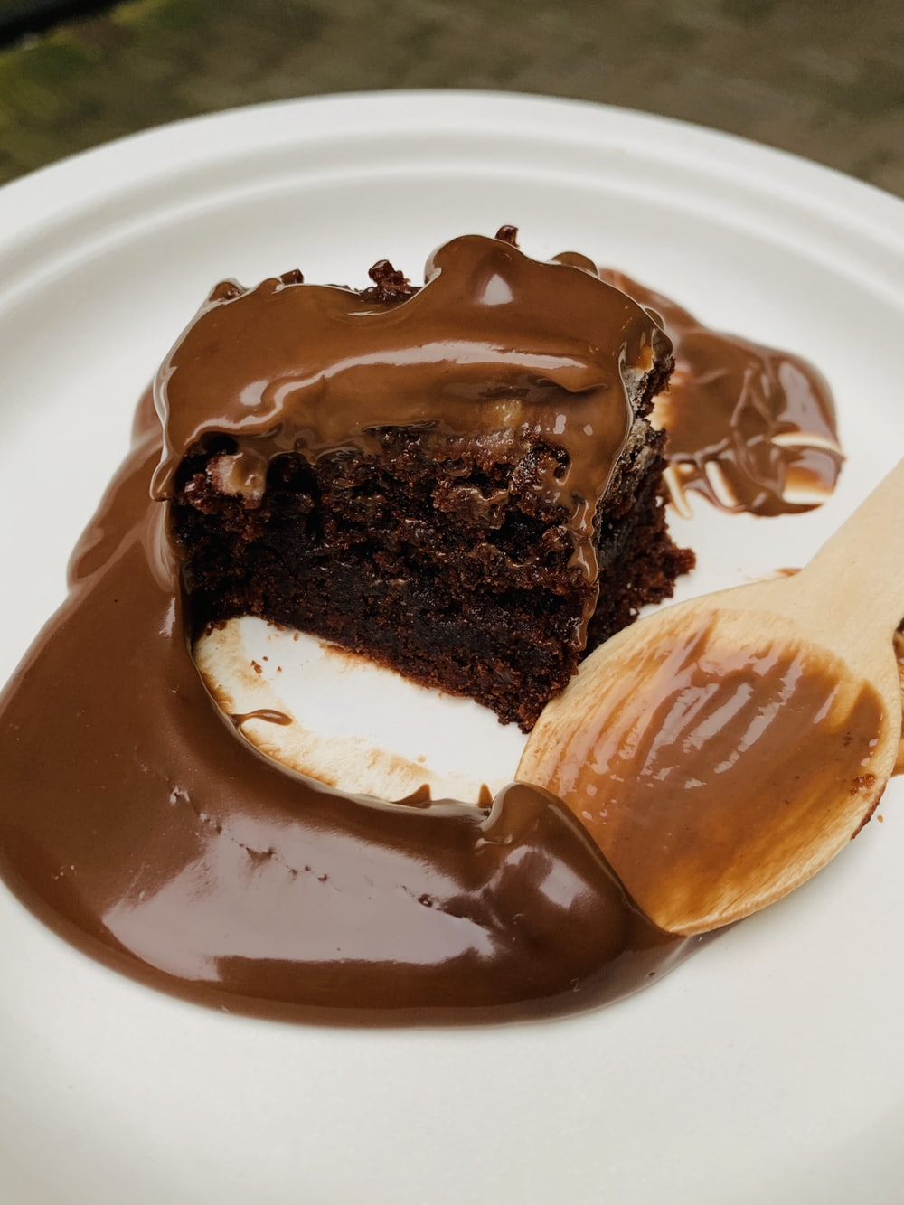 moist chocolate cake on round white plate