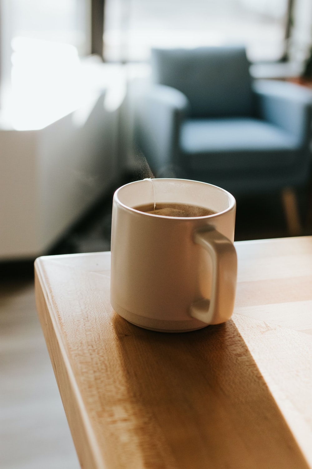 mug of coffee on top of a wooden table