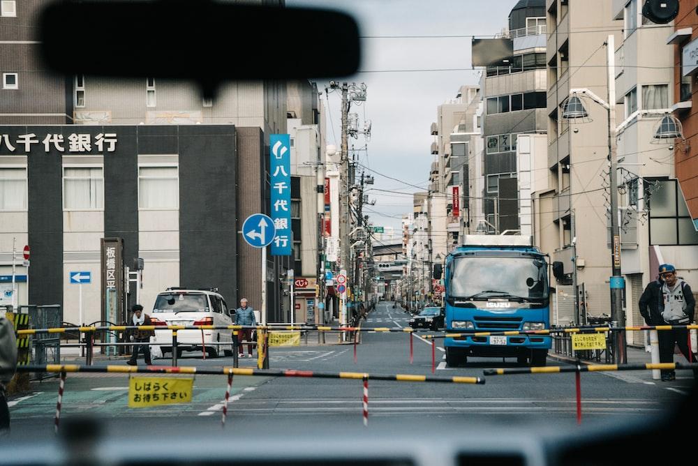 blue vehicle on street