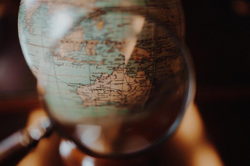 shallow focus photo of desk globe