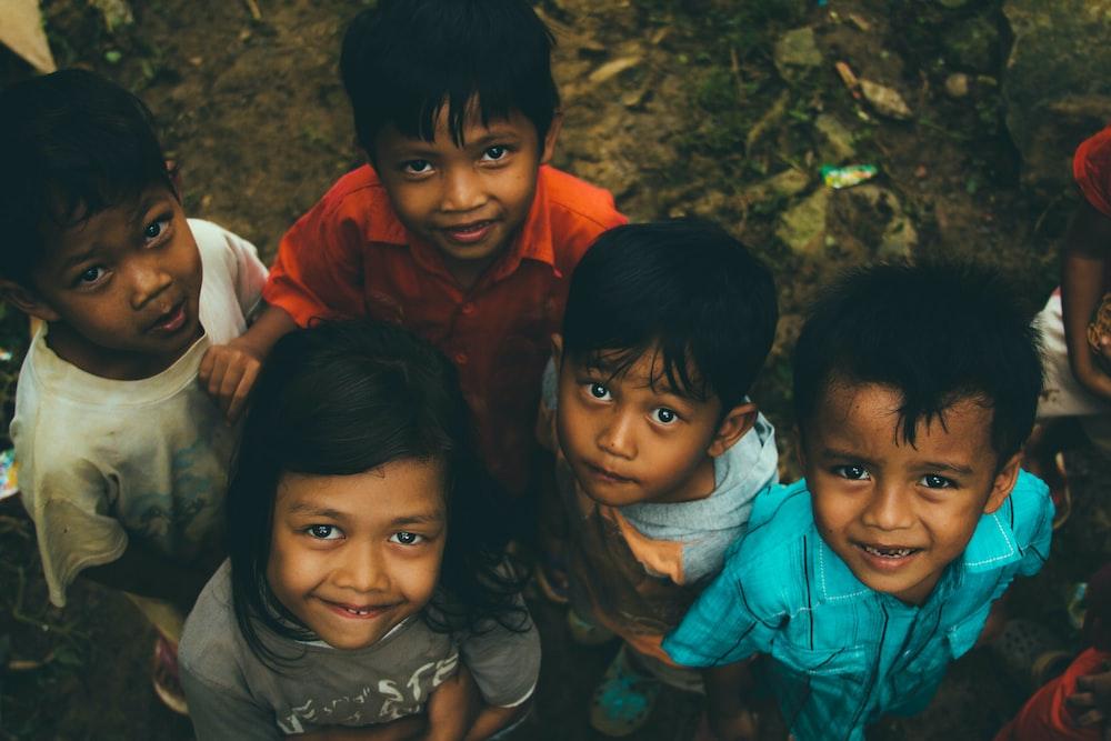 children on brown soil