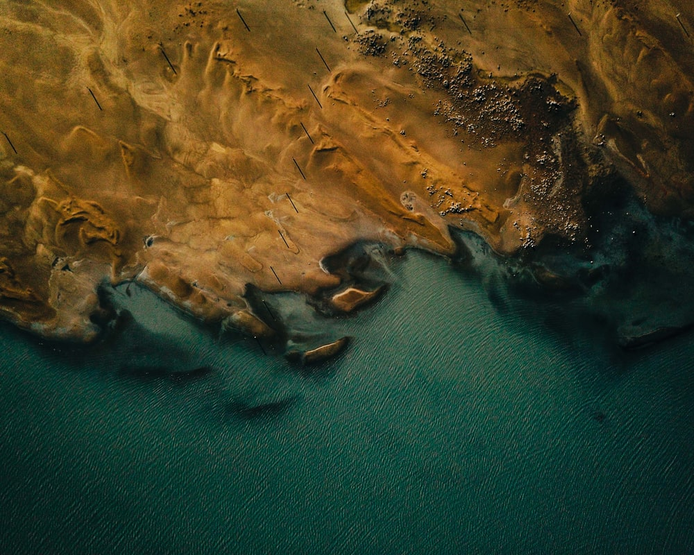 aerial photography of body of water and desert view