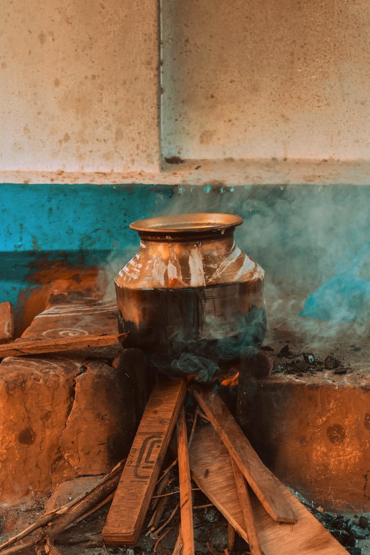 metal jar on firewoods