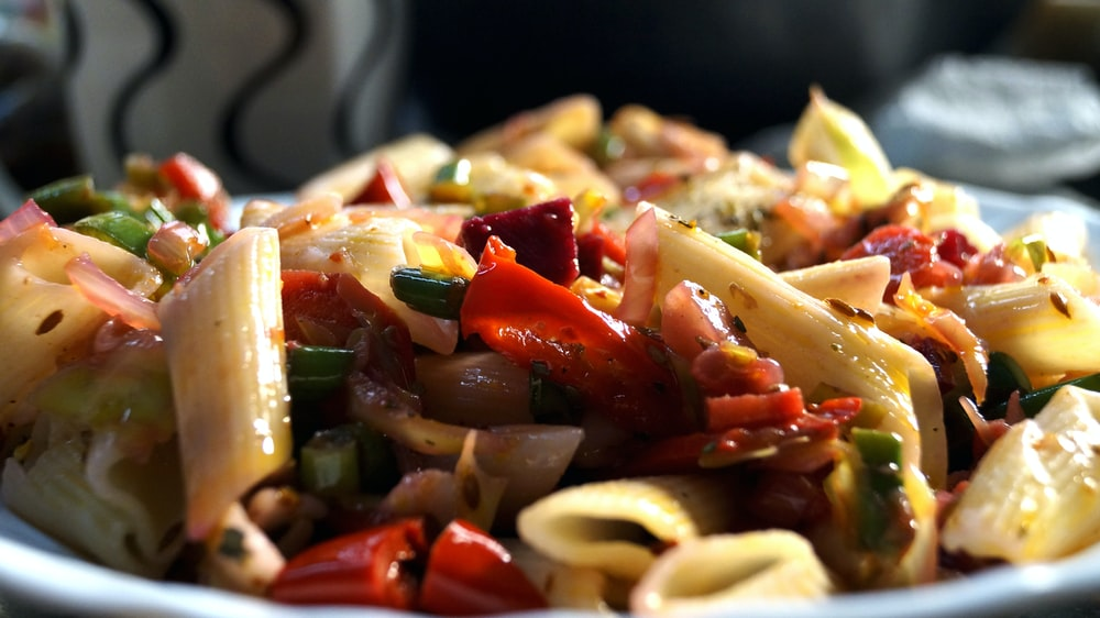 food photography of cooked pasta with slice of ehrbs