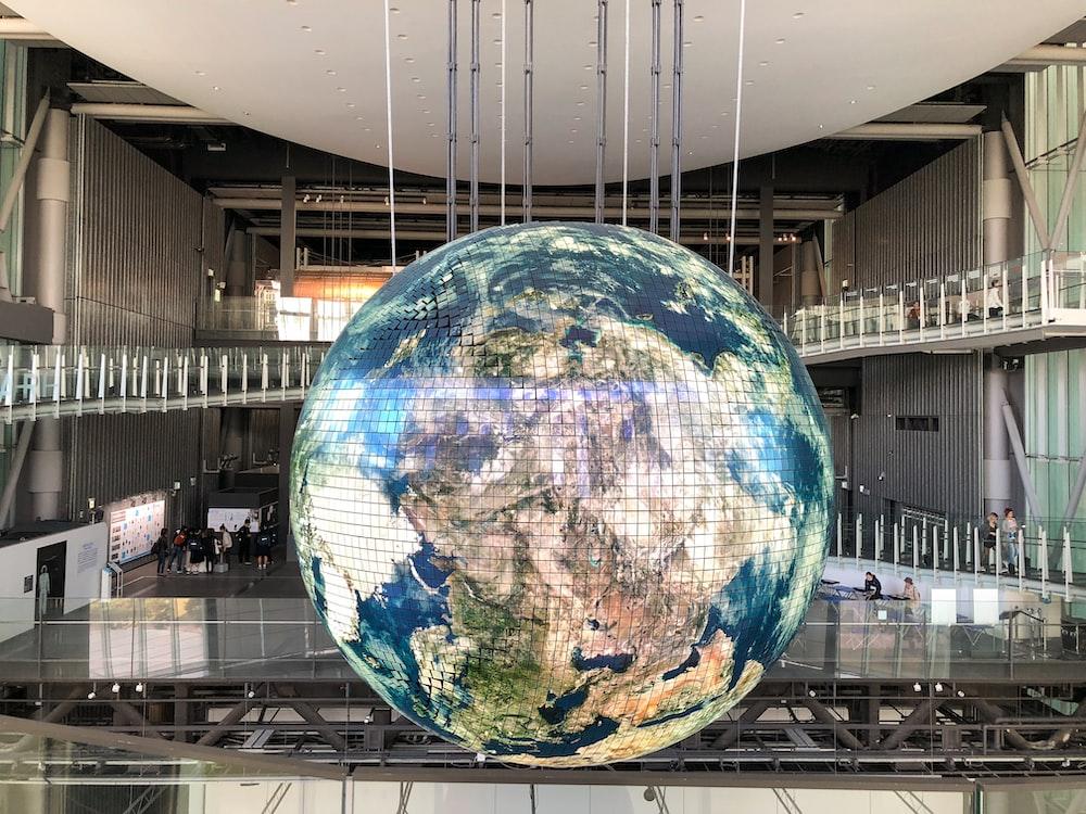 giant globe inside building