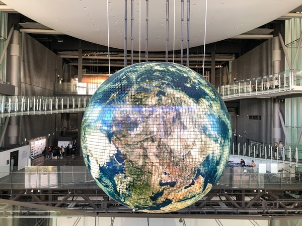 Creative Industries Fund. giant globe inside building