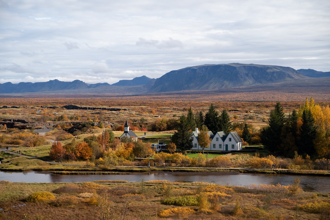 Small church and houses close to the river in Iceland