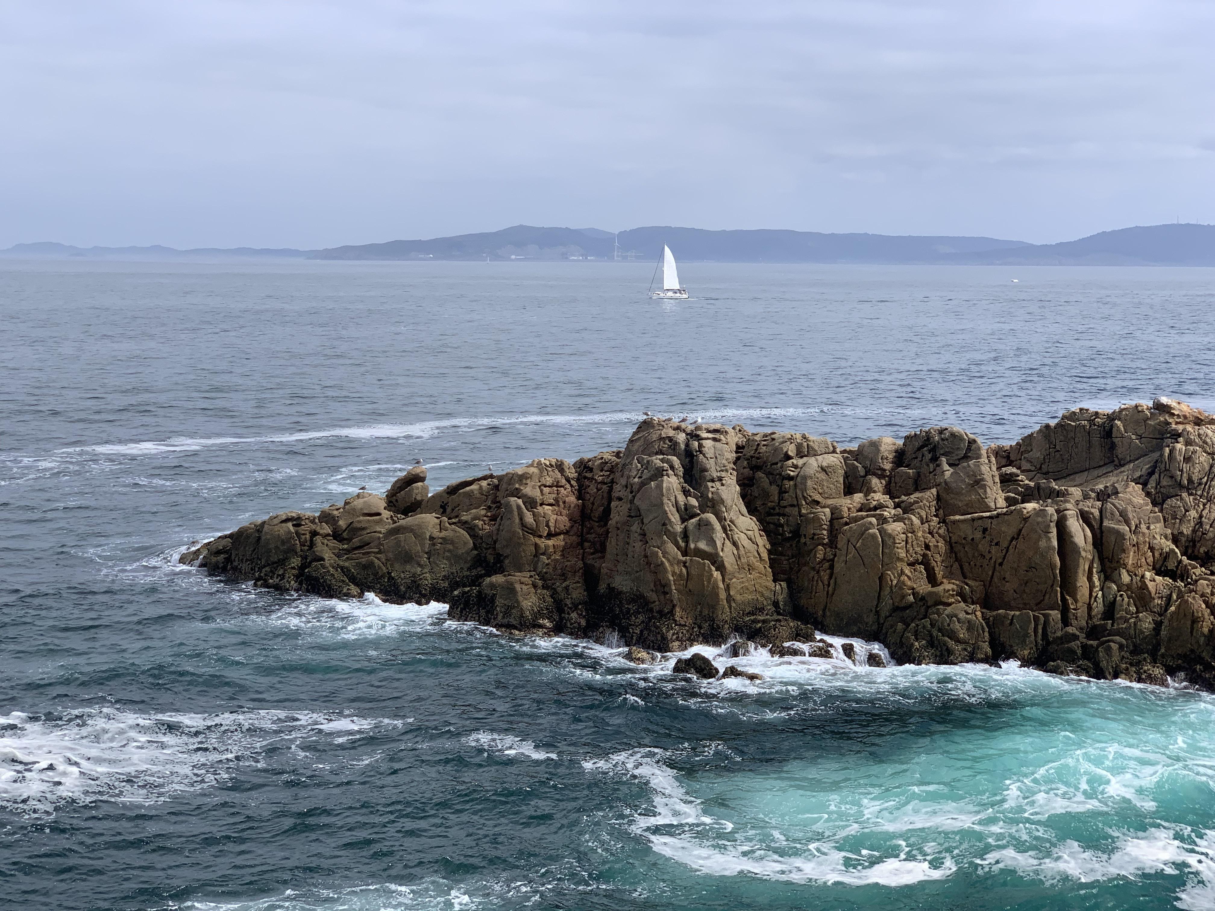 Coast of A Coruña. North of Spain. View of a sailing boat