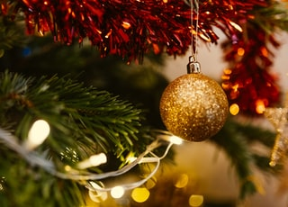 closeup photo of gold glittered Christmas bauble
