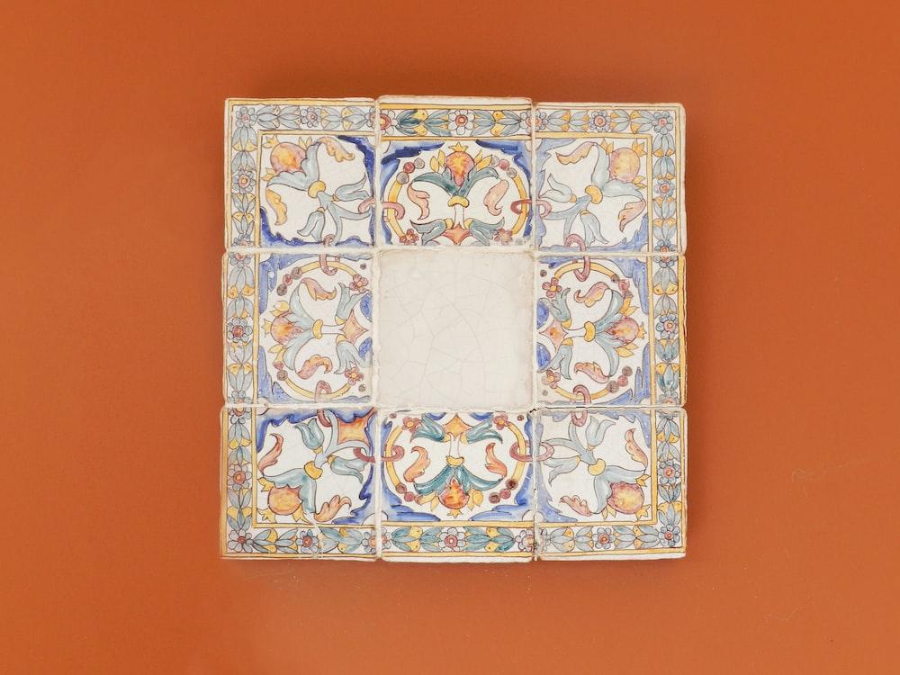 Square Blue And Multicolored Wall Decor On Orange Photo Free Art Image Unsplash