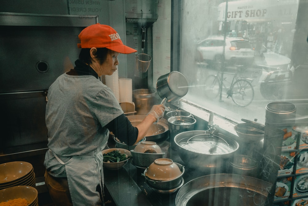 woman cooking in store