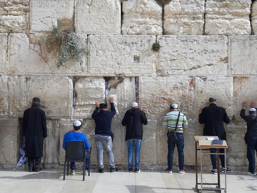 men facing wall