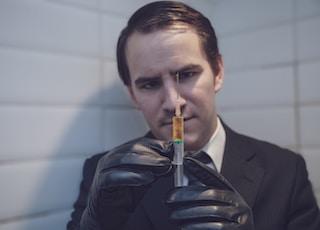 man holding syringe