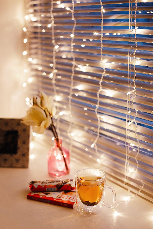 rose, mug, and string lights