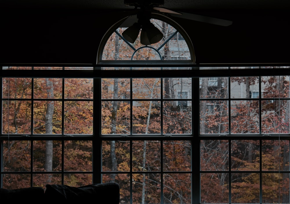 black multi-pane window during day