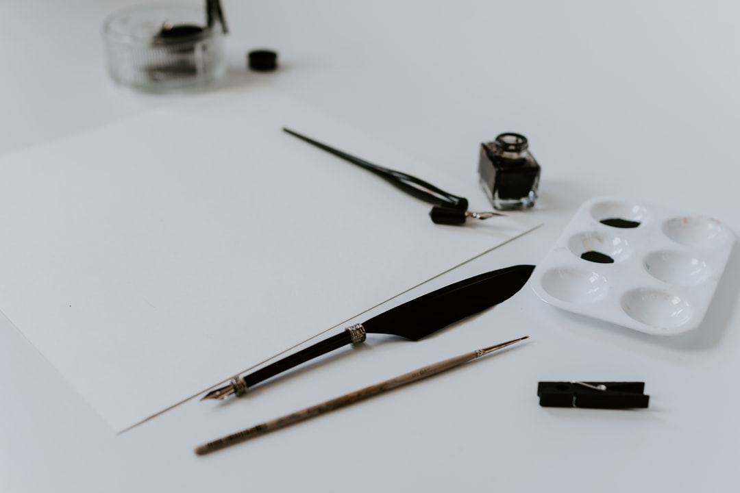 white paper and calligraphy writing tools