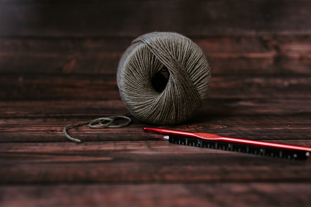 gray yarn ball on table