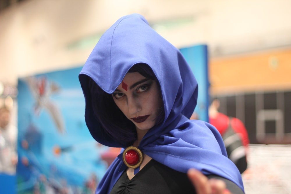 woman wearing DC Raven costume indoors