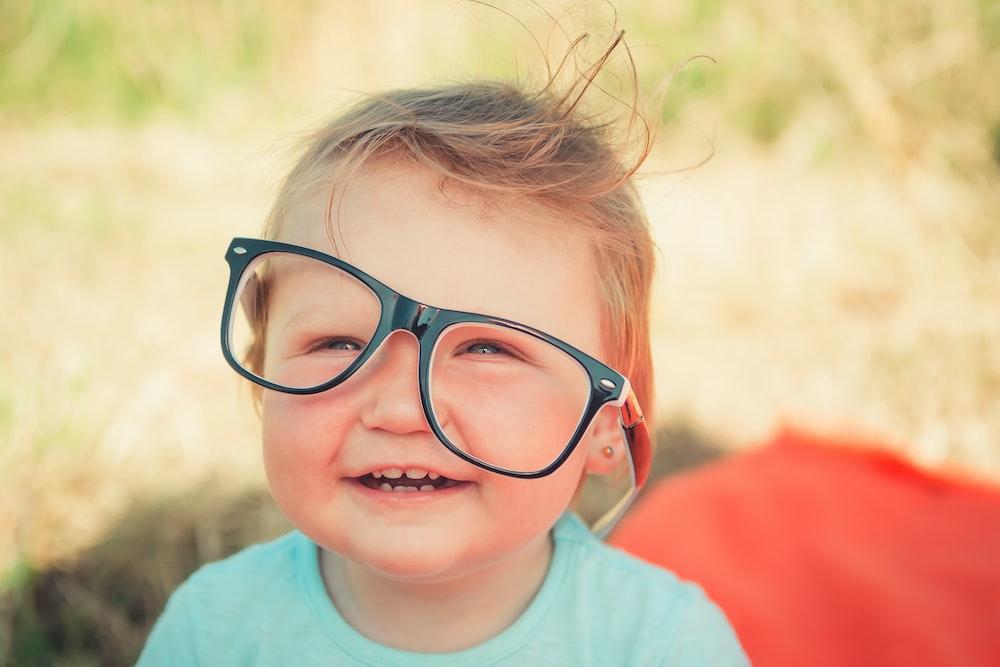 baby wearing black framed eyeglasses