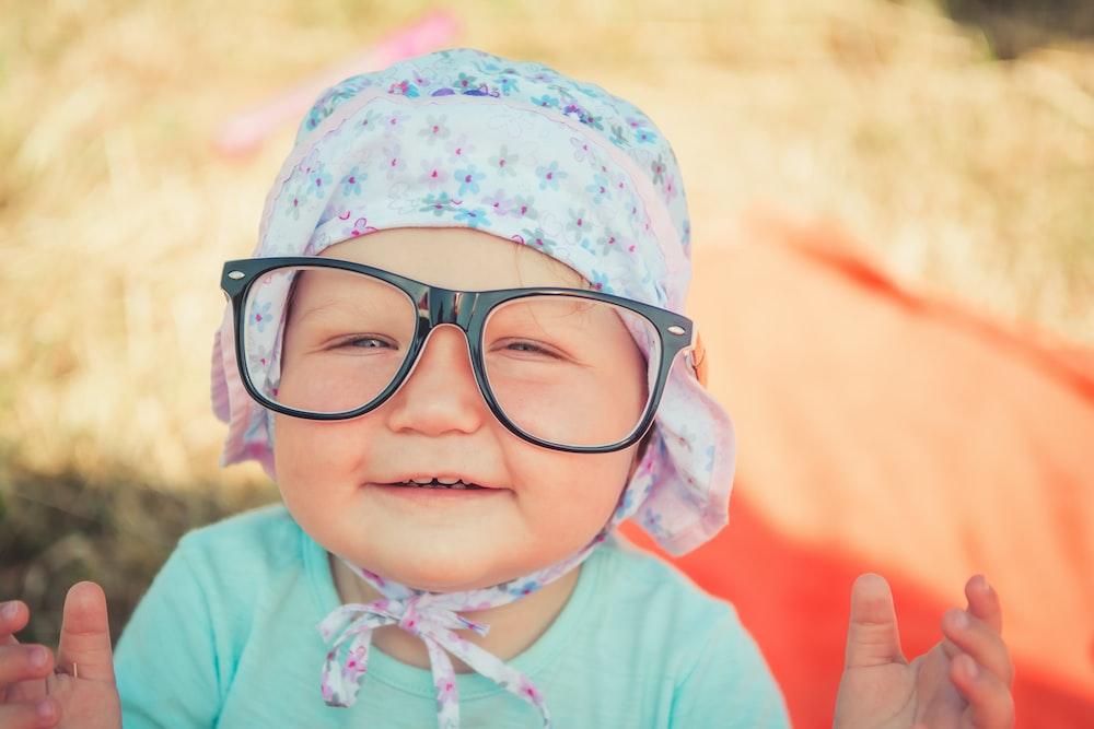 toddler wearing black framed eyeglasses