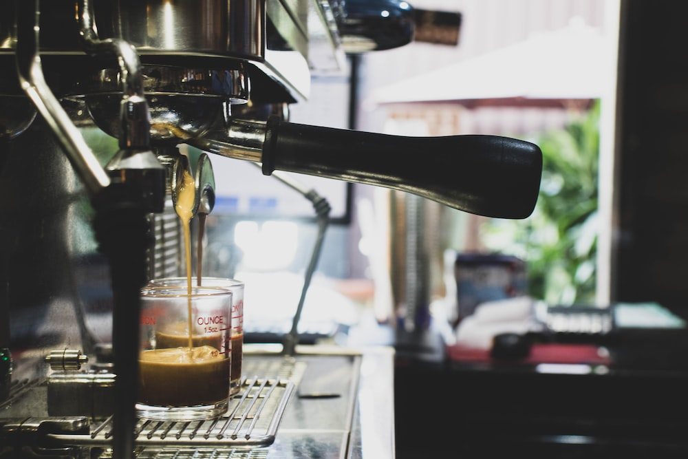 coffee pouring on glass